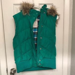 Green vest with removable hood